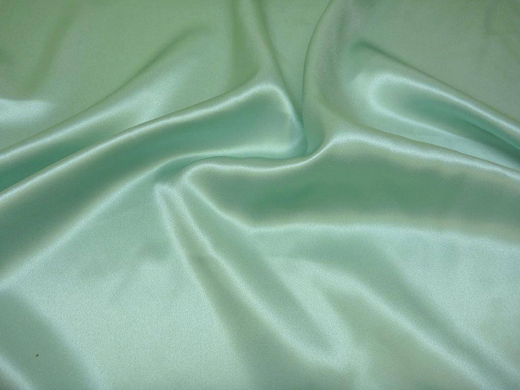 Tkanina jedwabna satyna w kolorze jasnym zielonym